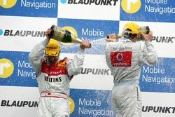 Podium: champagne for Bernd Schneider and Heinz-Harald Frentzen