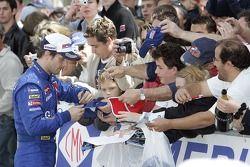 Winner Sébastien Loeb signs autographs