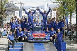 Winners Sébastien Loeb and Daniel Elena celebrate with their team