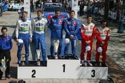 Podium: winners Sébastien Loeb and Daniel Elena, with second place Marcus Gronholm and Timo Rautiain