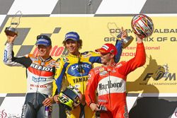 Podium: race winner Valentino Rossi with Nicky Hayden and Loris Capirossi