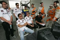 Spyker Squadron team members watch practice action