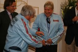 Bernie Ecclestone and Herbie Blash, FIA observer in the retro jackets they once worn when they worke