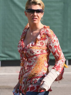 Corina Schumacher arrives at the circuit with her left arm and hand in a bandage