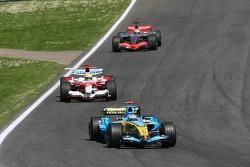 Fernando Alonso leads Ralf Schumacher