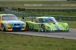 #76 Krohn Racing Ford Riley: Jorg Bergmeister, Colin Braun passes #05 Sigalsport BMW BMW M3: Matthew