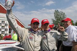Race winners Mike Rockenfeller and Patrick Long celebrate