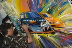 An artist paints Kevin's victory in Phoenix
