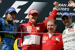 Podium: race winner Michael Schumacher with Fernando Alonso, Jean Todt and Juan Pablo Montoya