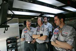 Midland F1 Racing team members watch practice action