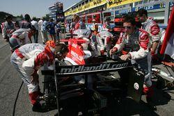 Midland F1 Racing team members on the starting grid