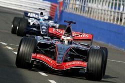 Kimi Raikkonen leads Nico Rosberg