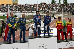 Podium: winners Sébastien Loeb and Daniel Elena, with second place Petter Solberg and Phil Mills, an