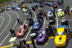 The Pro Stock cars line up in staging