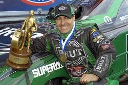 Ron Capps displays his trophy