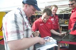 Nicolas Lapierre signs autographs