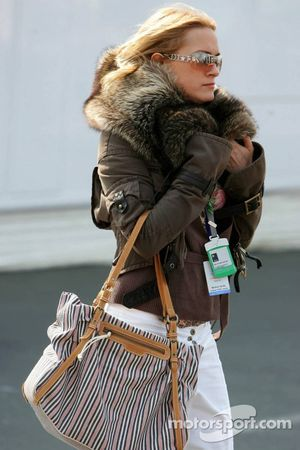 Girl in the paddock with a winter jacket while it's 20+ degrees