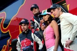 Neel Jani, Vitantonio Liuzzi and Scott Speed with a Formula Una girl