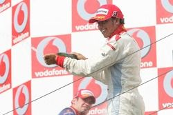 Lewis Hamilton race winner, sprays champagne