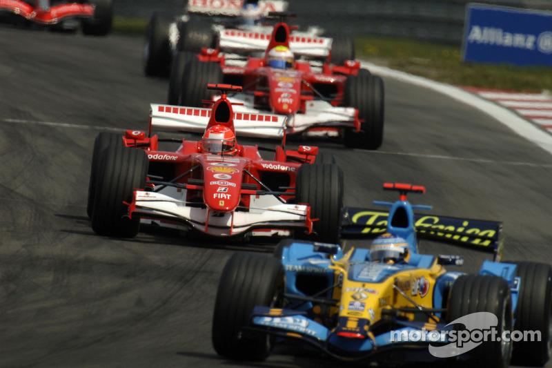 Fernando Alonso leads Michael Schumacher