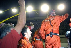 Dale Earnhardt Jr.'s crew start to celebrate as Dale crosses the finish line to take the win