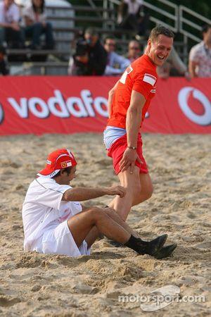 Vodafone Ferrari Beach Soccer Challenge: as Michael Schumacher stands up Felipe Massa pulls down Mic