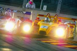 Battle between #16 Dyson Racing Team Lola B06/10 AER: James Weaver, Butch Leitzinger and #7 Penske M