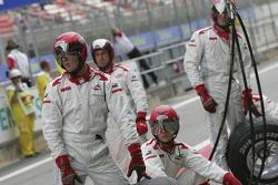 ART Grand Prix crew prepare for a pit stop