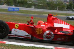 Michael Schumacher waves to the fans