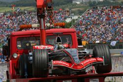 The car of Juan Pablo Montoya is taken back to the pits