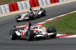 Rubens Barrichello leads Jenson Button