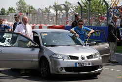 King of Spain Juan Carlos and Fernando Alonso go for a lap of the circuit in a Renault Megane