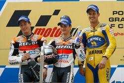 Podium: racewinnaar Dani Pedrosa met Nicky Hayden enColin Edwards