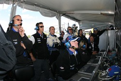 James Weaver and Dyson Racing crew members watch qualifying