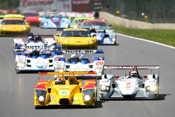 Start: battle for the lead between #6 Penske Motorsports Porsche RS Spyder: Sascha Maassen, Lucas Luhr and #2 Audi Sport North America Audi R8: Rinaldo Capello, Allan McNish