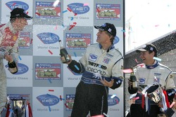 LMP1 podium: champagne for James Weaver and Butch Leitzinger