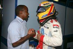 Lewis Hamilton celebrates pole position with his Father Anthony Hamilton