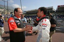Lewis Hamilton celebrates pole position with Frederic Vasseur