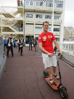 Michael Schumacher leaves the stewards building after a meeting