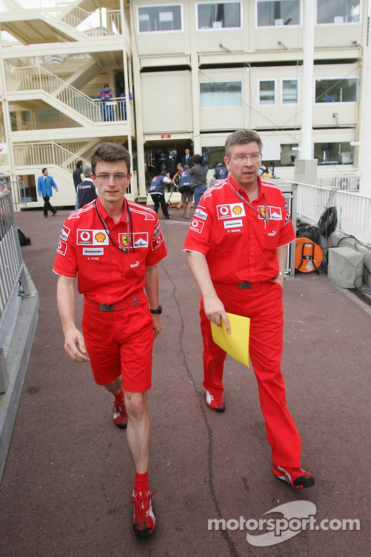 Chris Dyer and Ross Brawn leave the stewards building after a meeting regarding Michael Schumacher's