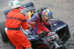 Nicolas Lapierre is helped from his car