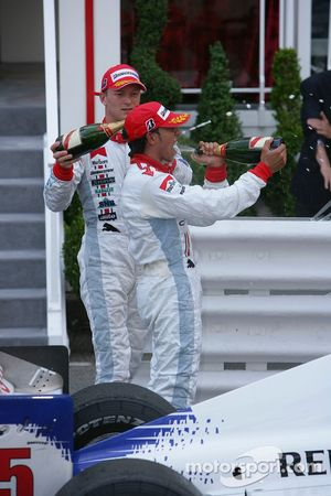 Lewis Hamilton 1st, and Alexandre Premat 3rd spray champagne