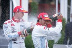 Lewis Hamilton 1st, sprays champagne with Alexandre Premat 3rd
