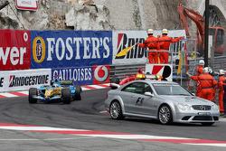 Fernando Alonso follows the safety car