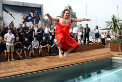 The team of Red Bull Racing and sporting director Christian Horner in a Superman cape jumps into the