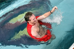Sporting director Christian Horner in a Superman cape in the pool on the deck of the Red Bull Energy