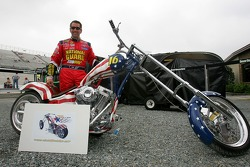 Greg Biffle stands by a motorcycle that will be auctioned off for the Greg Biffle Foundation
