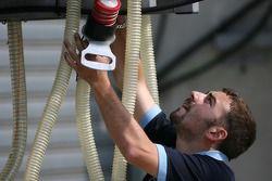 Team member prepares pit area