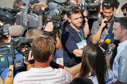 Ralf Schumacher talks with reporters