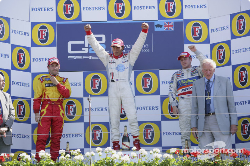Podium: Race winner Lewis Hamilton, second place, Timo Glock, third place, Adam Carroll